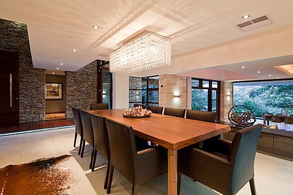 large dining area with modern furniture and stone walls