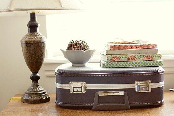 Books arranged on a vintage suitcase