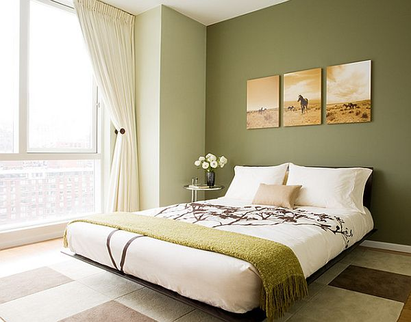 Modern bedroom decor with an Eileen Gray side table