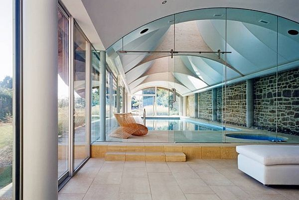 modern home indoor pool with comfy lounge