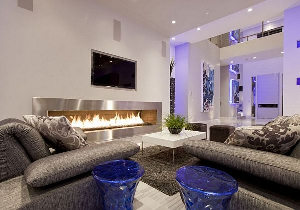 A highly modern living room with a rather large fireplace