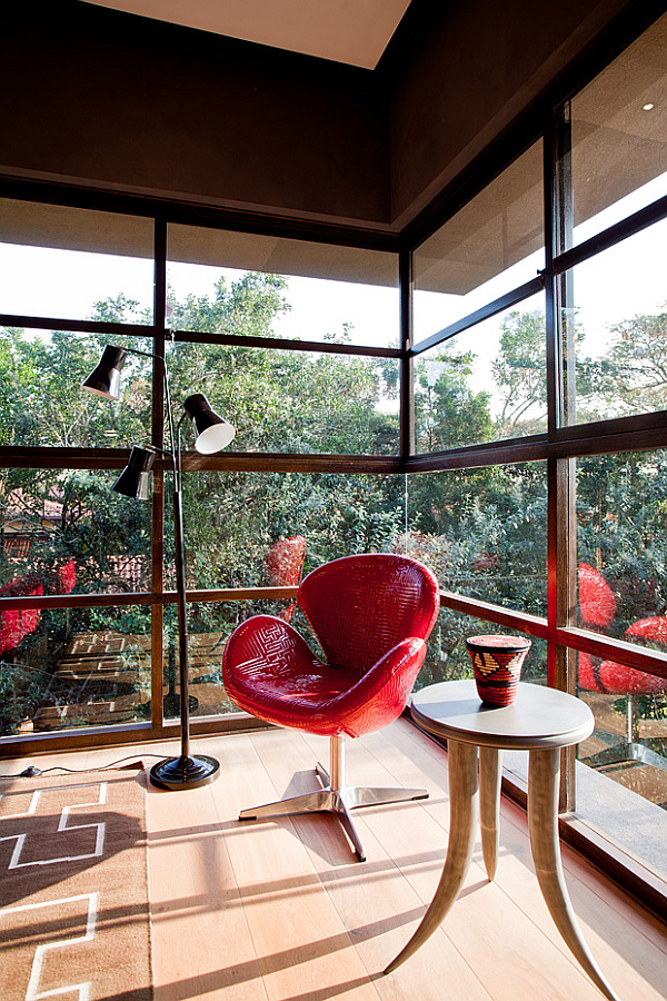 red chair and small diy coffee table made from elephant tusks