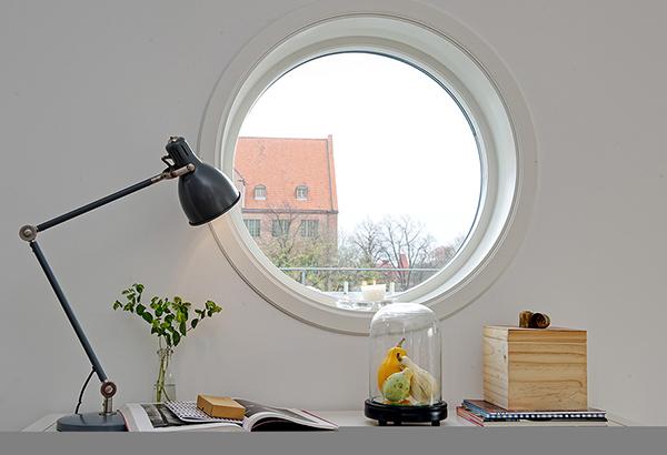 Timeless design for modern scandinavian attic apartment for 12 round window