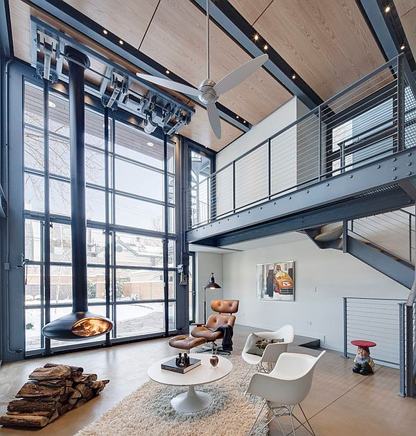 Steel and glass living room with suspended fireplace