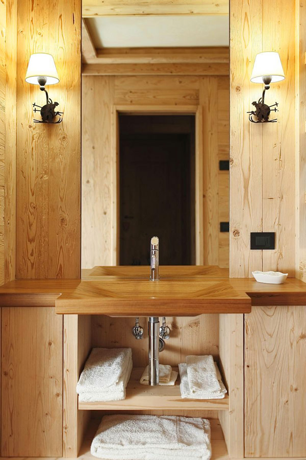 wooden bathroom with wall sconce