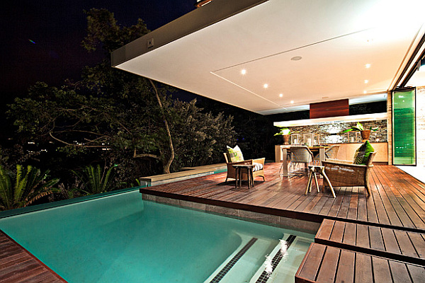 wooden deck with bar and small pool