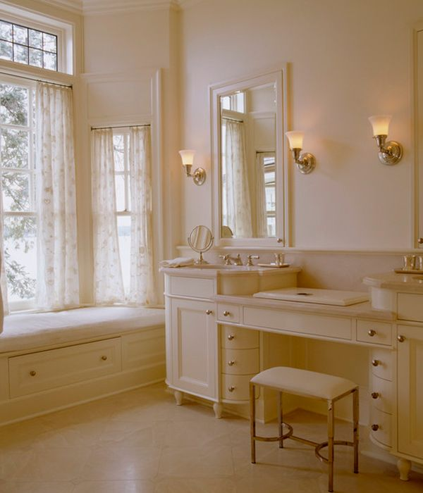 Ambient lighting and warm hues enhance the richness of this cream colored bathroom vanity