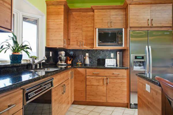 Bamboo cabinetry and a touch of green give this contemporary Californian kitchen an Asian flavor