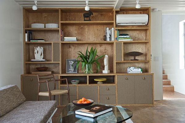 Beautiful shelf with wooden hues gives the home a natural touch