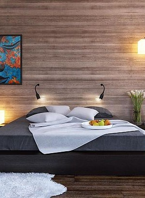 Black platform bed with a modern wood clad bedroom wall