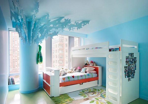 A blue tree in a girl's bedroom