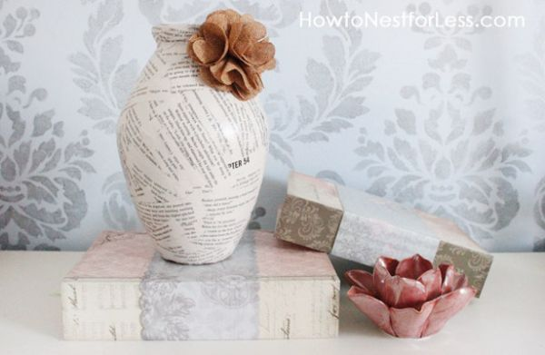 Book pages decorate this old vase giving it a new look