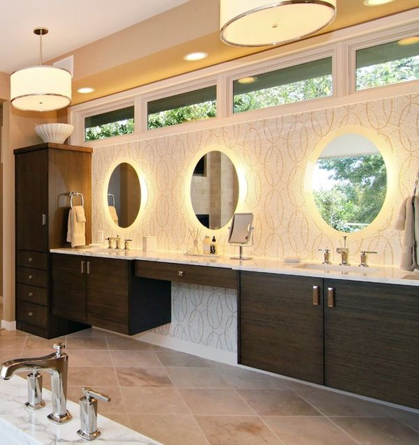 breathtaking lighting and beautiful vanity give this bathroom a