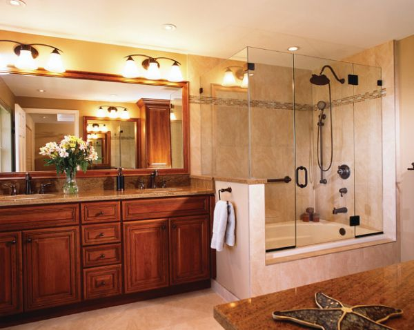 Cherry wood vanity and large glass shower and bathtub enclosure give this bathroom a classic touch 25 Glass Shower Doors for a Truly Modern Bath