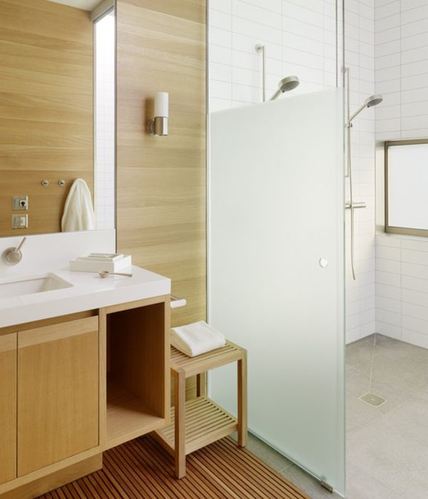Clean and well defined lines along with custom design grace this striking bathroom with glass shower