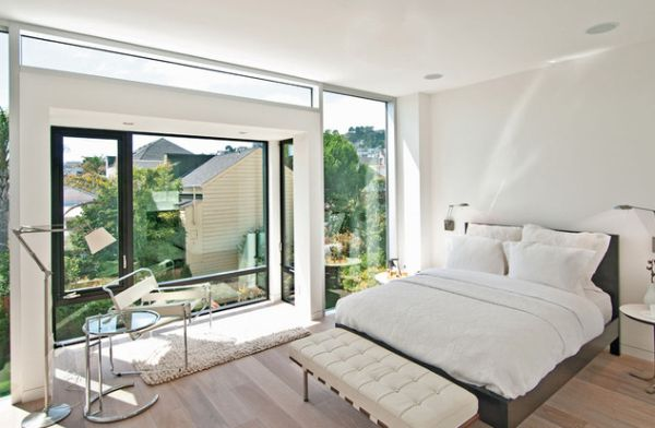 Contemporary bedroom with an all white template looks picture perfect