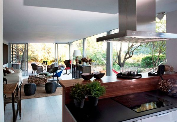 Contemporary kitchen that is visually connected with the rest of the container home