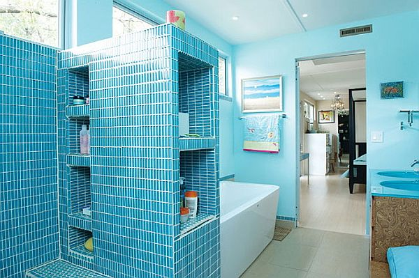 Cool blue hues make up a refreshing bath area