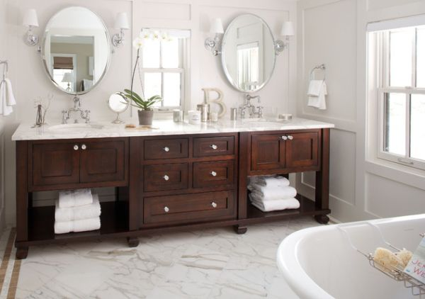 Exquisite bathroom vanity in dark tones complements the pristine white backdrop