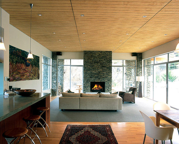 Fireplace mirrors the home's exterior stone