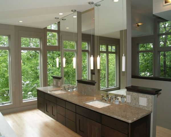 Floating vanity along with ampe use of glass give this master bath a spa-like feel