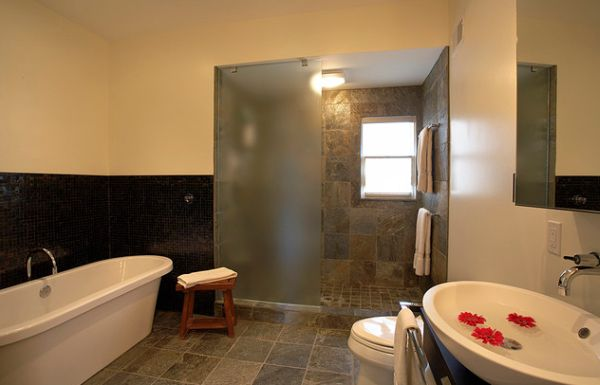 Frosted glass shower panel and doors give this bathroom a tranquil atmosphere