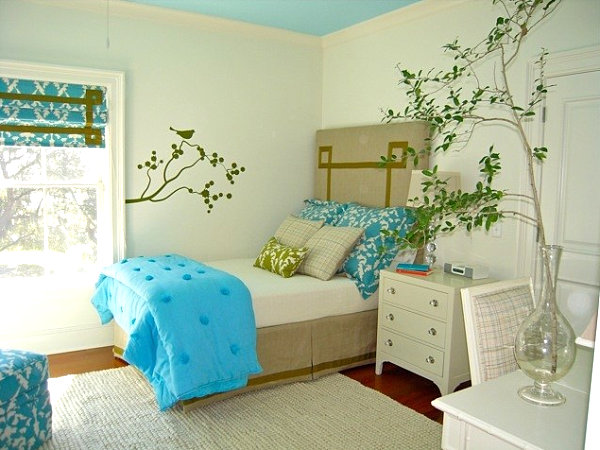 Girl's room with tree decal