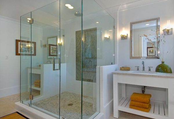 Glass shower area creates a spa-like relaxing environment with its cool design