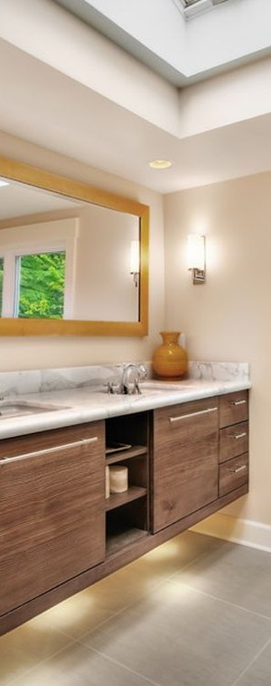 Gorgeous bathroom vanity enhanced with smart use of serene lighting