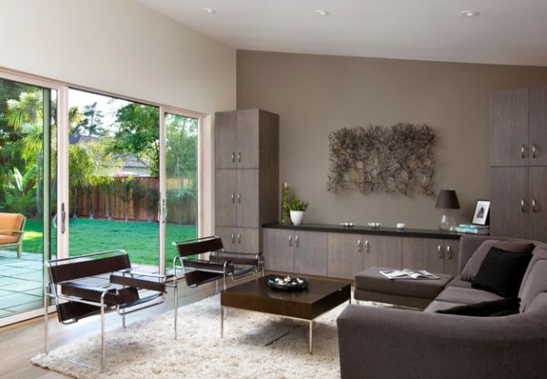 Gorgeous cabinetry and innovative wall art along with sleek modern furnishings