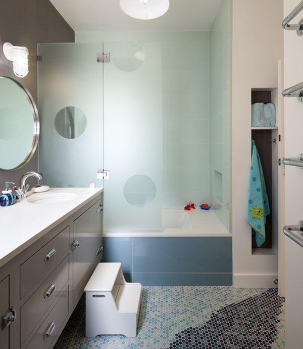 Imaginative transluscent glass enclosure creates a vibrant look in cool blue for the kids' bathroom