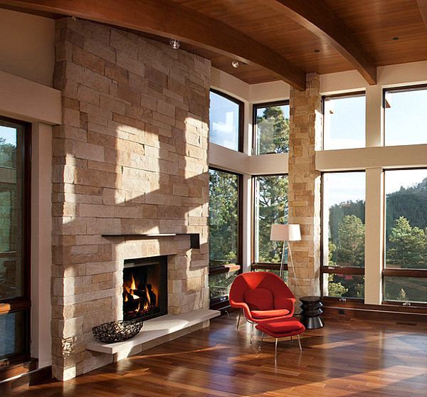 Light stone fireplace with a bright chair