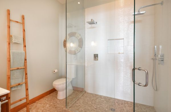 ... Lovely modern bathroom uses natural tones and glass shower space to  create a refreshing feel