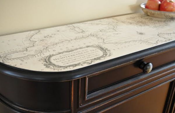 A vintage chest refurbished with an old map