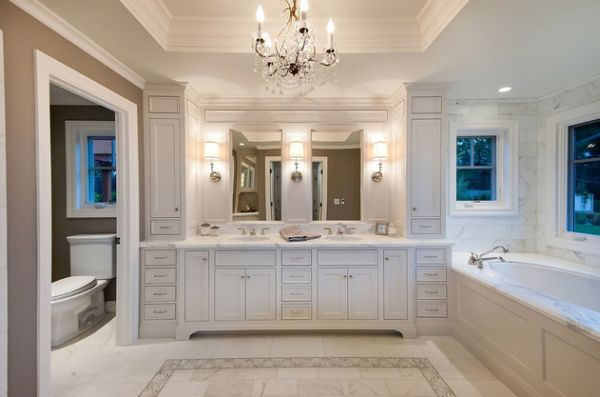 Marble flooring, chandeliers and tasteful cabinets make this bathroom truly indulgent