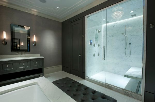 Master bathroom with glass doors offers visual connectivity with the bedroom