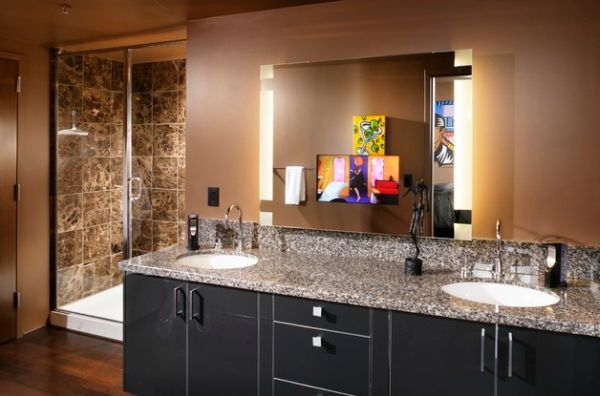 Mirrors with side lighting and sober tones give this masterbath a dark look
