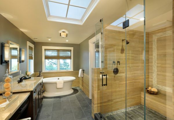 Modern bathroom in yellow and gray with spacious glass shower area