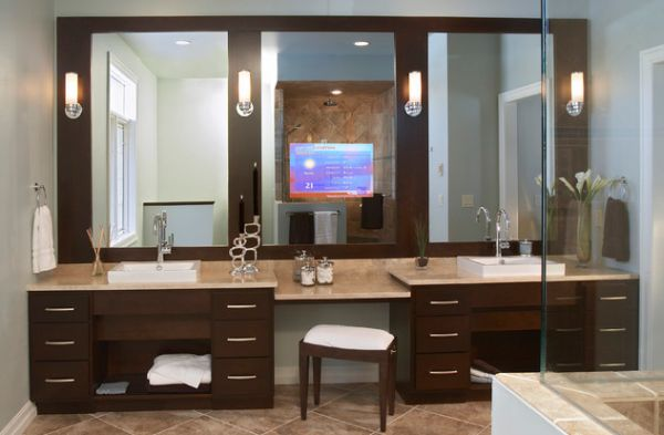 Modern bathroom vanity design with stunning use of mirrors and lighting above it
