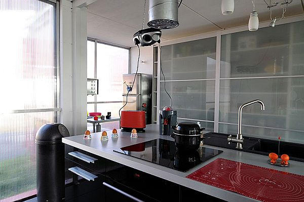 Modern kitchen with an organized stainless steel countertop