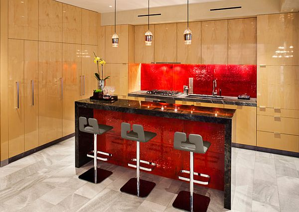 Modern kitchen with red accent backsplash and island