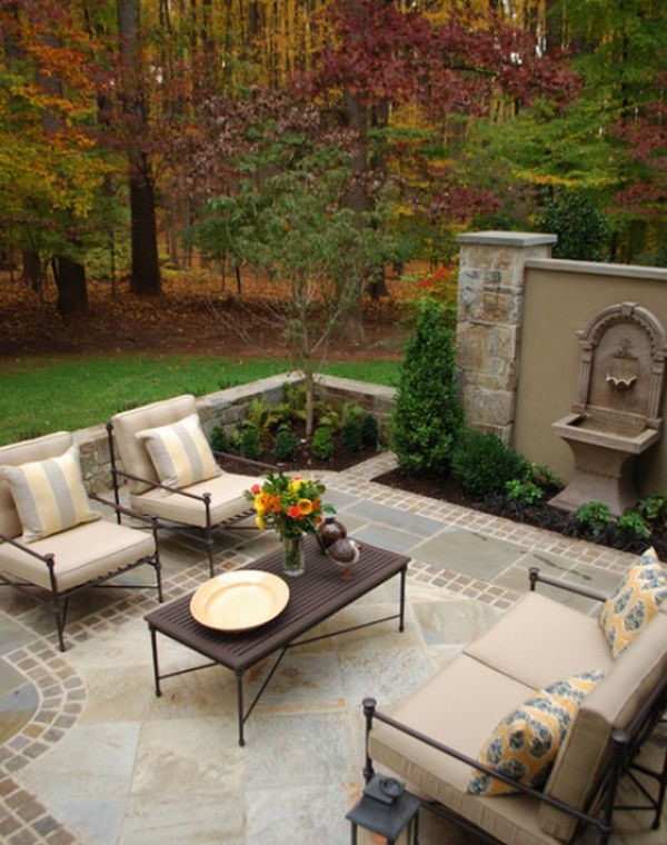 roman style patio design with a mosaic pattern floor