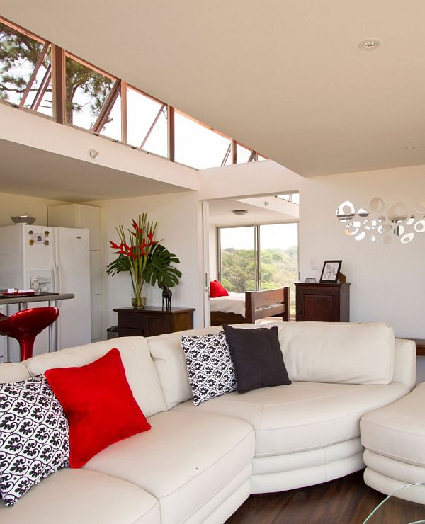 Plush couch along with skylights offer an airy feel