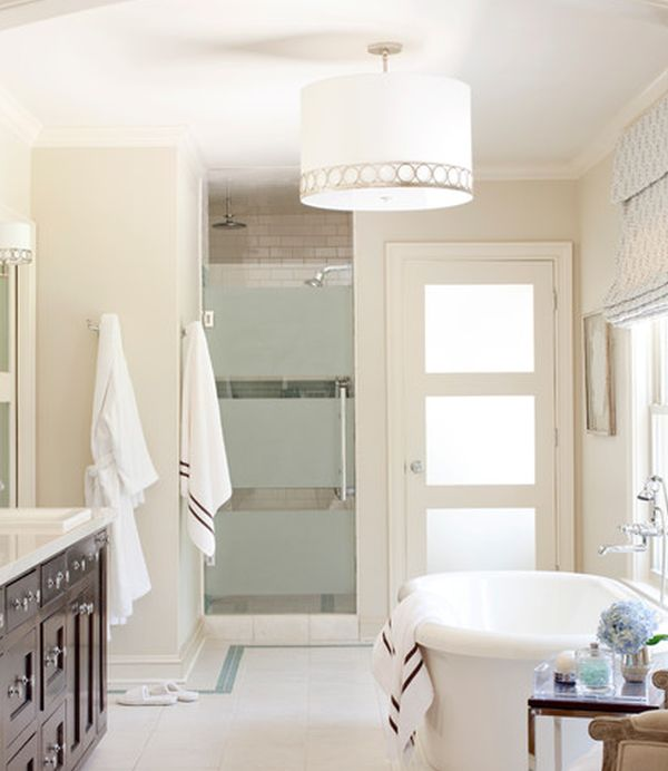Pristine white bath with gorgeous framed glass shower door