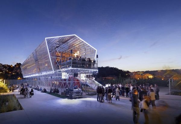 Shipping container unit encapsulated in a glass exterior