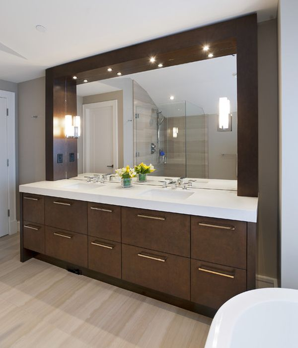Sleek and stylish modern bathroom vanity sparkles thanks to well placed lighting