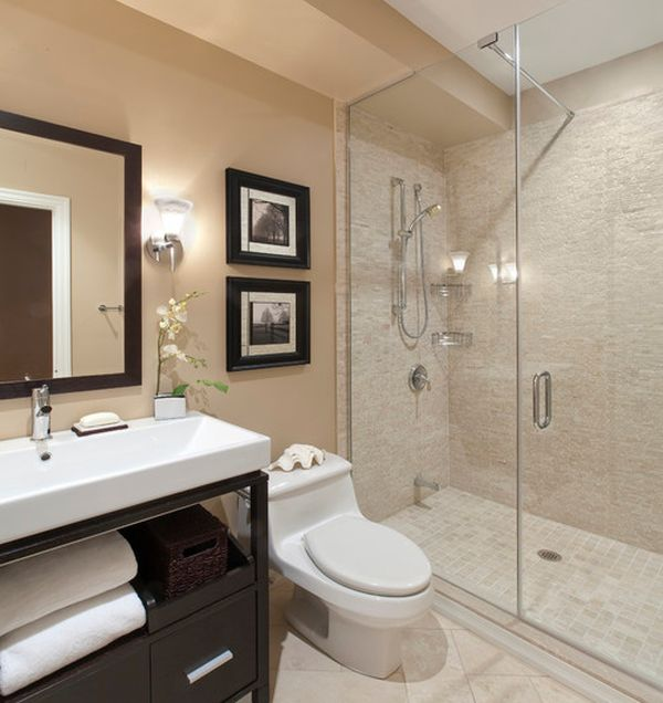 Spacious modern bathroom with frameless shower enclosure in glass