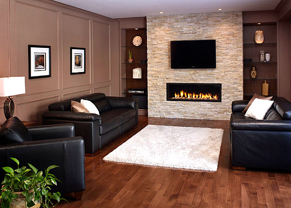 Stone fireplace with TV overhead