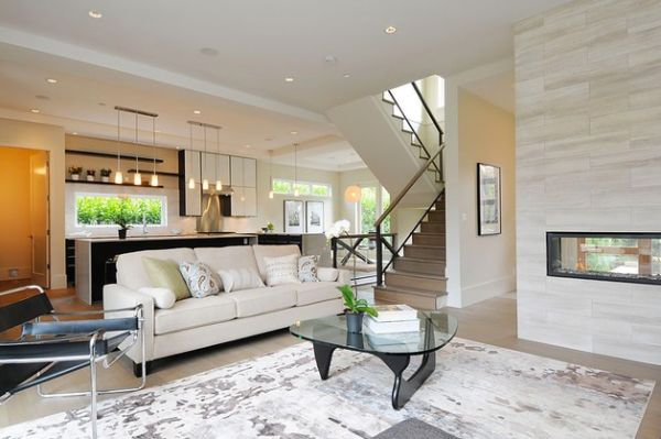 View In Gallery Stylish And Sleek House With A Gorgeous Fireplace Wily Chair Among Decor