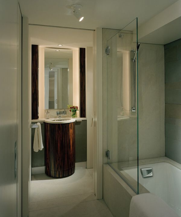Stylish glass shower enclosure that saves up on space in a smart fashion